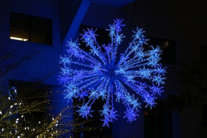 A beautiful blue snowflake over an ice skating rink.